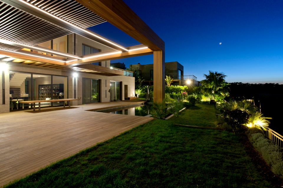 residence with clima louver pergola